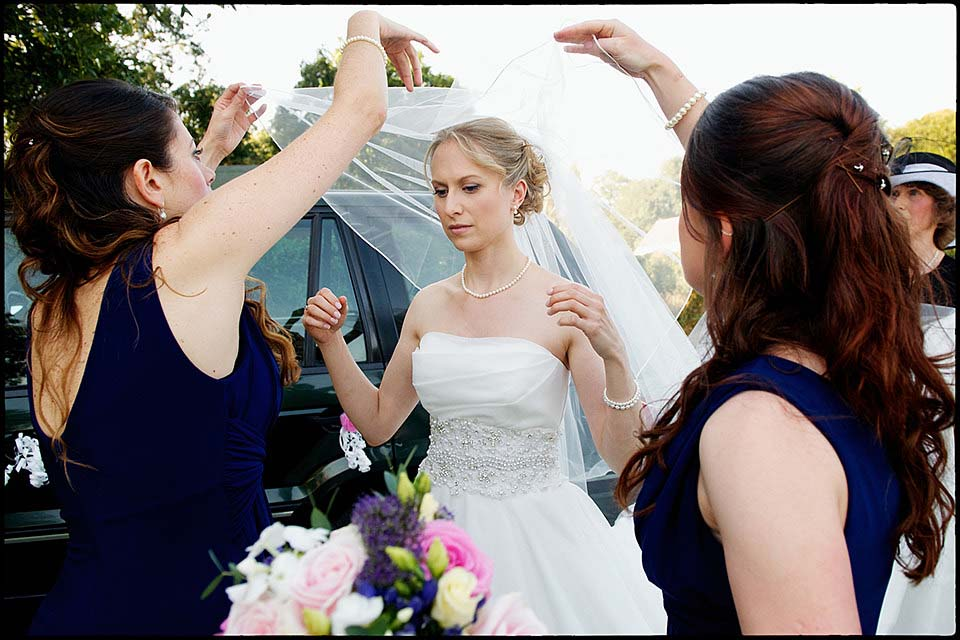 Bride Putting Veil On