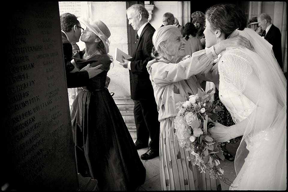 Couple Greeting Wedding Guests