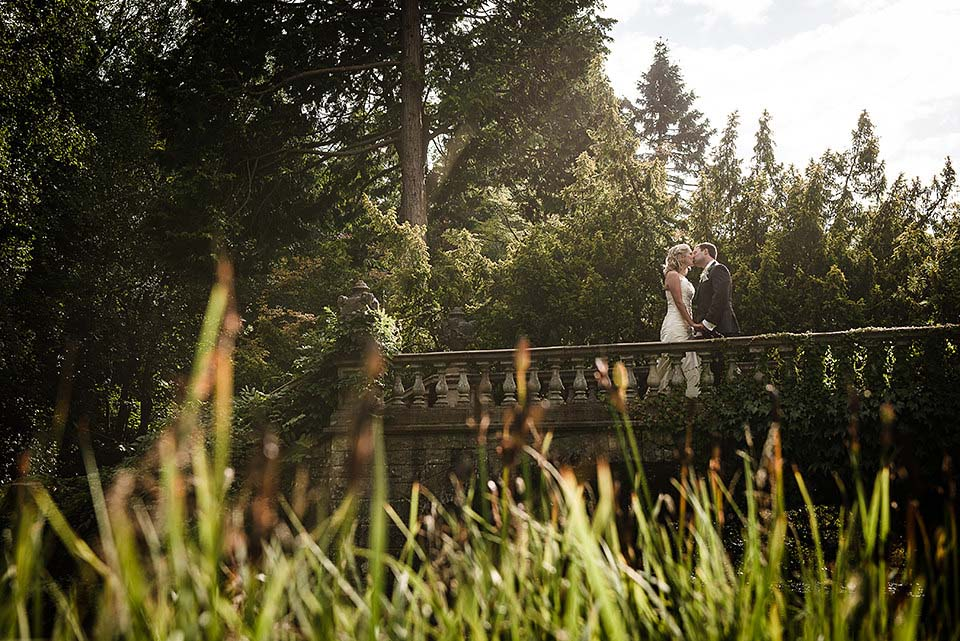 Bride and Groom Kissing on Bridge