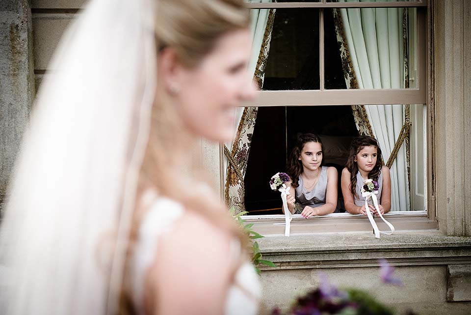 Bridesmaids Looking Through Window