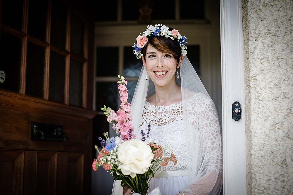 Bride smiling at doorway