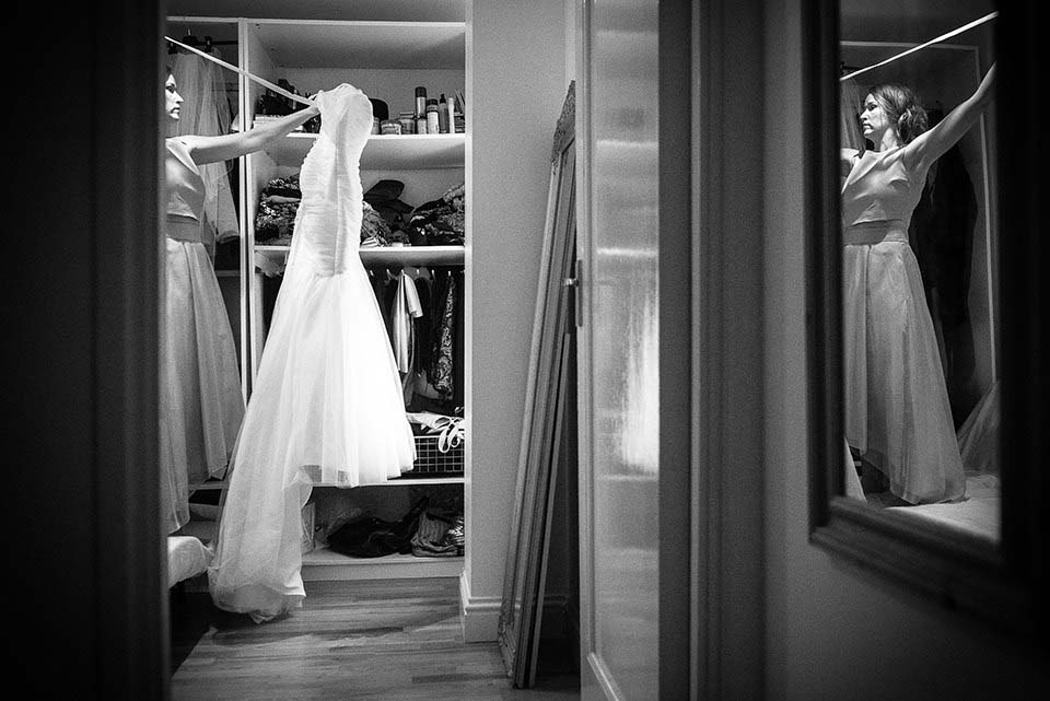 Bridesmaid Preparing Wedding Dress