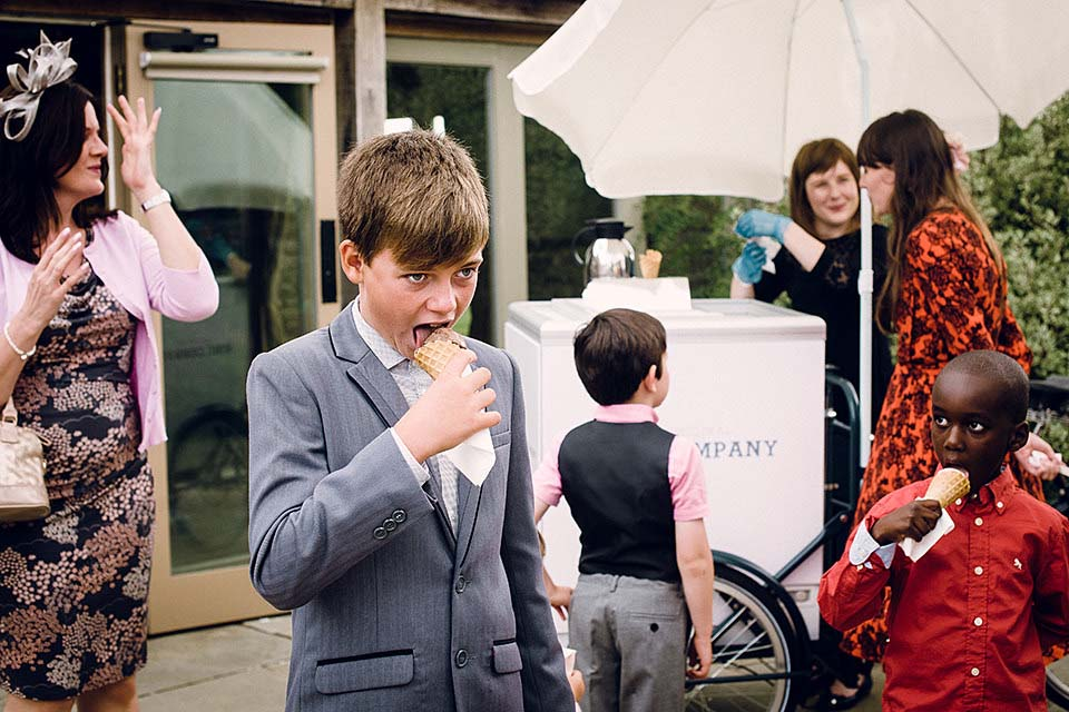 Children Eating Ice Creams At Wedding