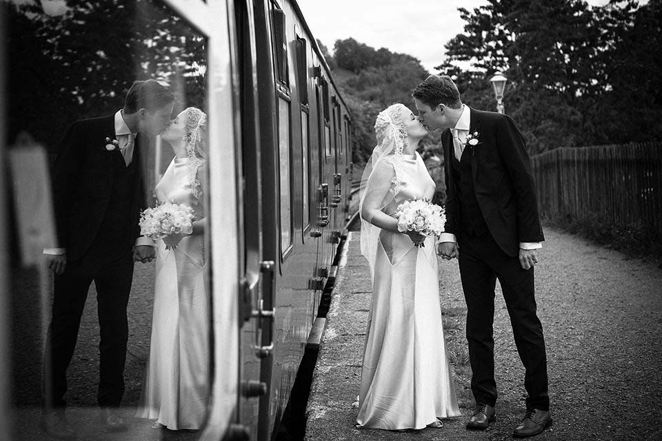 Wedding Couple Kissing Next To Train